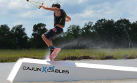 photo of brennan delahoussaye wakeboarding at cajun x cables